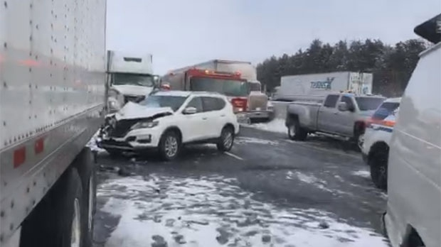 Damaged vehicles are shown after a pileup on Highway 401 on Feb. 13, 2019. (Kerry Schmidt/Twitter)