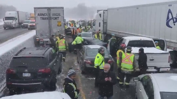 Emergency workers are seen on Highway 401 WB near Milton after a massive pileup. (Kerry Schmidt/OPP)