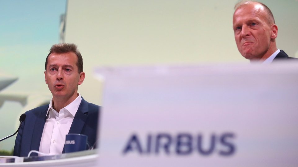 Airbus CEO Tom Enders, right, and Airbus President Commercial Aricraft Guillaume Faury attend the presentation of Airbus 2018 results in Toulouse, southern France, Thursday, Feb.14, 2019. European plane manufacturer Airbus said Thursday it will stop making its superjumbo A380 in 2021 for lack of customers, abandoning the world's biggest passenger jet and one of the aviation industry's most ambitious and most troubled endeavors. (AP Photo/Fred Scheiber)