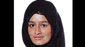 This undated photo issued by the Metropolitan Police shows Shamima Begum. A pregnant British teenager who ran away from Britain to join Islamic State extremists in Syria four years ago has said she wants to come back to London, but her path home is not clear. Shamima Begum told The Times newspaper in a story published Thursday Feb. 14, 2019, that she wants to come back to London. (Metropolitan Police via AP)