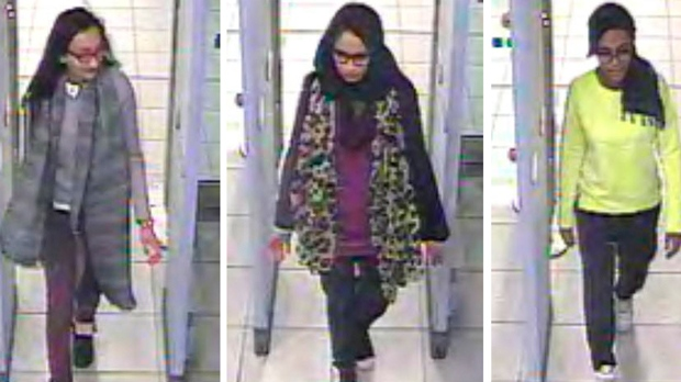 This Monday Feb. 23, 2015 file handout image of a three image combo of stills taken from CCTV issued by the Metropolitan Police shows Kadiza Sultana, left, Shamima Begum, center, and Amira Abase going through security at Gatwick airport, south England, before catching their flight to Turkey. Shamima Begum told The Times newspaper in a story published Thursday Feb. 14, 2019, that she wants to come back to London. (Metropolitan Police via AP)