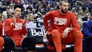 Toronto Raptors guard Jeremy Lin, left, and centre Marc Gasol look on from the bench during first half NBA basketball action against the Washington Wizards in Toronto on Wednesday, February 13, 2019. THE CANADIAN PRESS/Frank Gunn