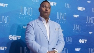 Host Russell Peters poses on the red carpet ahead of the Juno awards show in Ottawa on April 2, 2017. THE CANADIAN PRESS/Justin Tang
