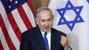 Israeli Prime Minister Benjamin Netanyahu reacts during a bilateral meeting with United States Vice President Mike Pence in Warsaw, Poland, Thursday, Feb. 14, 2019. (AP Photo/Michael Sohn)