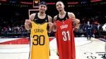 In this Dec. 29, 2018, file photo, Portland Trail Blazers guard Seth Curry, left, and his brother, Golden State Warriors guard Stephen Curry, exchange jerseys after an NBA basketball game in Portland, Ore. The Curry brothers are returning to their hometown of Charlotte, N.C, for the NBA All-Star weekend. Stephen, a two-time league MVP, will join younger brother Seth in the 3-point shootout on Saturday night at the Spectrum Center and then play in his sixth straight All-Star game on Sunday. (AP Photo/Steve Dykes, File)
