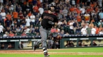 Arizona Diamondbacks' Daniel Descalso watches his two-run home run against the Houston Astros during the ninth inning of a baseball game Sunday, Sept. 16, 2018, in Houston. (AP Photo/David J. Phillip)