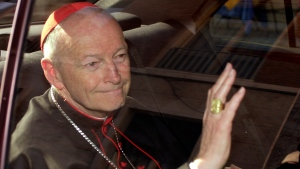 In this April 23, 2002 file photo Cardinal Theodore McCarrick of the Archdiocese of Washington, waves as he arrives at the Vatican in a limousine. On Saturday, Feb. 16, 2019 the Vatican announced Pope Francis defrocked former U.S. Cardinal Theodore McCarrick after Vatican officials found him guilty of soliciting for sex while hearing Confession. (AP Photo/Andrew Medichini, file)