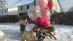 A makeshift memorial is shown outside the Brampton home where 11-year-old Riya Rajkumar was found dead. (Brandon Gonez)