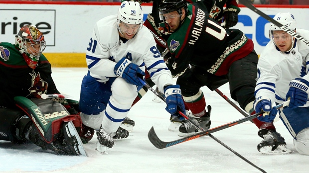 Toronto Maple Leafs center John Tavares (91) and left wing Zach Hyman (11)  battle with Arizona Coyotes defenseman Niklas Hjalmarsson (4) for the puck  as ... 41e5e090c