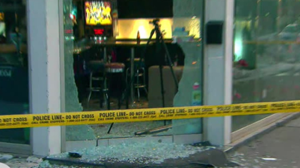 Shattered glass is pictured in front of Rivals Sports Bar on Danforth Avenue following a shooting Sunday February 17, 2019.