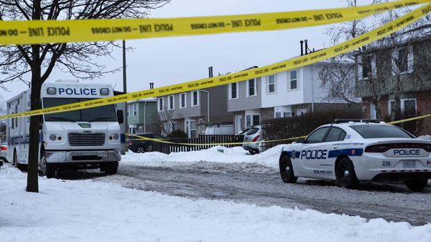 Police tape is seen outside of a house where a young girl was found dead in Brampton, Ont. on Friday, February 15, 2019. THE CANADIAN PRESS/Andrew Ryan