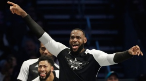 Team LeBron's LeBron James, of the Cleveland Cavaliers celebrates a basket against Team Giannis during the second half of an NBA All-Star basketball game, Sunday, Feb. 17, 2019, in Charlotte, N.C. (AP Photo/Chuck Burton)