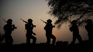 In this Oct. 2, 2016 file photo, Indian army soldiers patrol near the Line of Control in Nowshera sector, about 90 kilometers from Jammu, India. (AP Photo/Channi Anand, File)