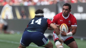Canada's Phil Mack, right, avoids a tackle from Mike Te'o of USA during the 2019 Rugby World Cup Qualifier in Hamilton, Ont., on June 24, 2017. Canada captain Phil Mack's welcome will likely be warm and short Sunday when the Toronto Arrows visit his Seattle Seawolves in Major League Rugby play. Introductions won't be needed. Thirteen of the Arrows' starting 15 are Canadian and nine members of the matchday 23 are Canadian internationals. THE CANADIAN PRESS/ Michael P. Hall
