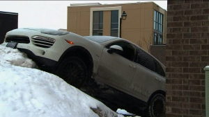 A stolen Porsche sits atop a snowbank after two suspects fled from police near Eglinton Avenue and Hurontario Road Monday February 18, 2019.