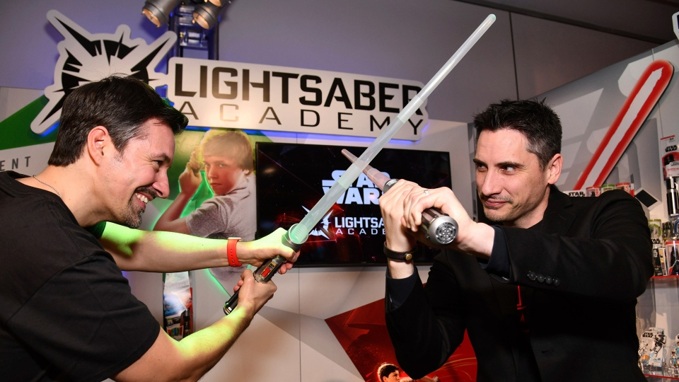 Demonstrators at the Hasbro, Inc. showroom battle using the STAR WARS LIGHTSABER ACADEMY Interactive Training System, which helps kids and fans learn official Star Wars moves, at the American International Toy Fair on Saturday, Feb. 16, 2019 in New York. (Charles Sykes/AP Images for Hasbro)