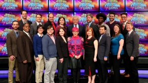 "This image released by Jeopardy Productions, Inc. shows, front row from left, Brad Rutter, Colby Burnett, Alan Lin, Seth Wilson, Larissa Kelly, Monica Thieu, Pam Mueller, Matt Jackson, Jennifer Giles and Ken Jennings, back row from left, Ben Ingram, Roger Craig, David Madden, Julia Collins, host Alex Trebek, Austin Rogers, Leonard Cooper, Alex Jacob and Buzzy Cohen on the set of the game show ""Jeopardy!""  (Jeopardy Productions, Inc. via AP)"
