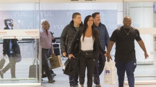 Passengers arrive at Trudeau airport in Montreal, Saturday, February 16, 2019. More than 100 Quebec tourists who had been trapped in Haiti amid violent street protests were flown back to Montreal on Saturday. THE CANADIAN PRESS/Graham Hughes