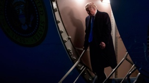 President Donald Trump arrives at Andrews Air Force Base, Md., Monday, Feb. 18, 2019, to board Marine One for a short trip to the White House. Trump returns from a holiday weekend at Mar-a-Lago. (AP Photo/Andrew Harnik)