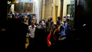 Policemen and residents surround the site of an explosion in the Gamaliya district, near Cairo's famed Khan el-Khalili tourist marketplace in Cairo, Egypt, late Monday, Feb. 18, 2019. (AP Photo/Amr Nabil)