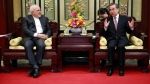Iranian Foreign Minister Mohammad Javad Zarif, left, and his Chinese counterpart Wang Yi, right, during their meeting at the Diaoyutai State Guesthouse in Beijing, China, Tuesday, Feb. 19, 2019. The foreign ministers of China and Iran met in Beijing on Tuesday amid efforts to preserve the 2015 nuclear deal with Tehran.(How Hwee Young/Pool Photo via AP)