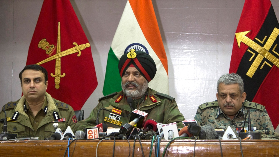 Indian Army's General Officer Commanding of the Srinagar-based 15 Corps Lt. Gen. K.J.S. Dhillon, center, speaks as Inspector General of Police Swayam Prakash Pani, left, and Inspector General of Central Reserve Police Force (CRPF) operation Zulfiqar Hassan sit by his side during a joint press conference in Srinagar, Indian controlled Kashmir, Tuesday, Feb. 19, 2019.  (AP Photo)