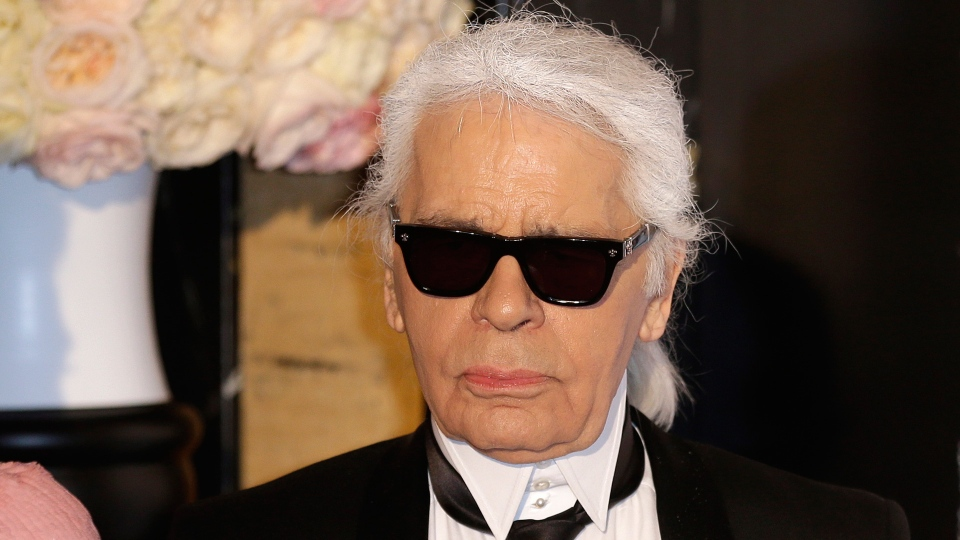 In this Saturday, March 28, 2015 file photo, Karl Lagerfeld poses for photographers as he arrives at the Rose Ball in Monaco. (AP Photo/Lionel Cironneau, File)