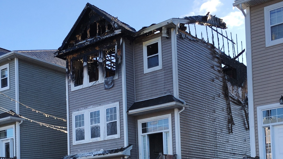 The aftermath of a house fire is seen in the Spryfield community in Halifax on Tuesday, February 19, 2019. THE CANADIAN PRESS/Rob Roberts