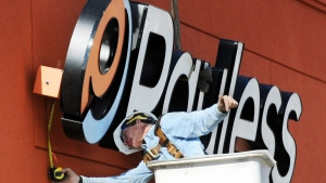 A crane operator installs a Payless Shoesource sign to the front of the store Thursday afternoon, Jan. 19, 2012, on Range Line Road in Joplin, Mo. Payless ShoeSource Canada Inc. says it will soon file for creditor protection in Canada and close all 2,500 of its North American stores this spring. THE CANADIAN PRESS/AP, The Joplin Globe, T. Rob Brown