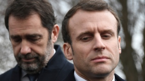 French President Emmanuel Macron and French Interior Minister Christophe Castaner, left, react as they visit the vandalized Jewish cemetery in Quatzenheim, eastern France, Tuesday Feb. 19, 2019. (Frederick Florin, Pool via AP)
