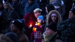 People attend a candlelight vigil held for Riya Rajkumar in Brampton, Ontario on Tuesday 19, 2019. Community members gathered in Brampton tonight to honour the 11-year-old girl allegedly killed by her father. THE CANADIAN PRESS/Chris Young