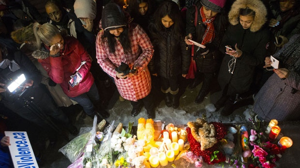 People pay their respects during candlelight vigil held for Riya Rajkumar in Brampton, Ontario on Tuesday 19, 2019. Community members gathered in Brampton tonight to honour an 11-year-old girl allegedly killed by her father. THE CANADIAN PRESS/Chris Young THE CANADIAN PRESS/Chris Young
