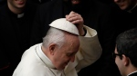 Pope Francis adjusts his skull-cap at the end of his weekly general audience in the Paul VI Hall at the Vatican Wednesday, Feb. 20, 2019. (AP Photo/Alessandra Tarantino)