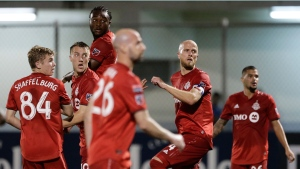 Players of Canada's Toronto FC looks a free kicks by Panama's Club Atletico Independiente FC during a CONCACAF Champions League soccer match in La Chorrera, Panama, Tuesday, Feb., 19, 2019 (AP Photo/Arnulfo Franco)