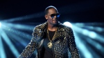 FILE - In this June 30, 2013 file photo, R. Kelly performs at the BET Awards in Los Angeles. Prosecutors will have to clear a series of high legal hurdles if they intend to charge R. Kelly anew and convict him, even if video evidence is available. Speculation the R&B star could face new charges arose after attorney Michael Avenatti said Thursday, Feb. 14, 2019, he recently gave prosecutors a VHS tape showing Kelly having sex with an underage girl. (Photo by Frank Micelotta/Invision/AP, File)