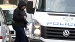 Smiljana Srnec who is suspected of killing her sister Jasmina Dominic is escorted to a police vehicle from a court in Varazdin, Croatia, Wednesday, Feb. 20, 2019. (AP Photo)
