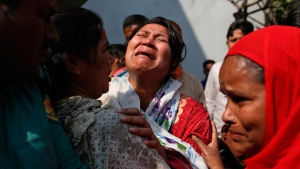 A Bangladeshi woman mourns the death of a relative in a fire, outside a morgue in Dhaka, Bangladesh, Thursday, Feb. 21, 2019. A devastating fire raced through at least five buildings in an old part of Bangladesh's capital and killed scores of people. (AP Photo/Rehman Asad)