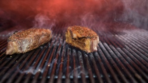 In this Tuesday, Nov. 27, 2018 photo, steak is grilled at the Gotham Bar and Grill in New York. (AP Photo/Mary Altaffer)