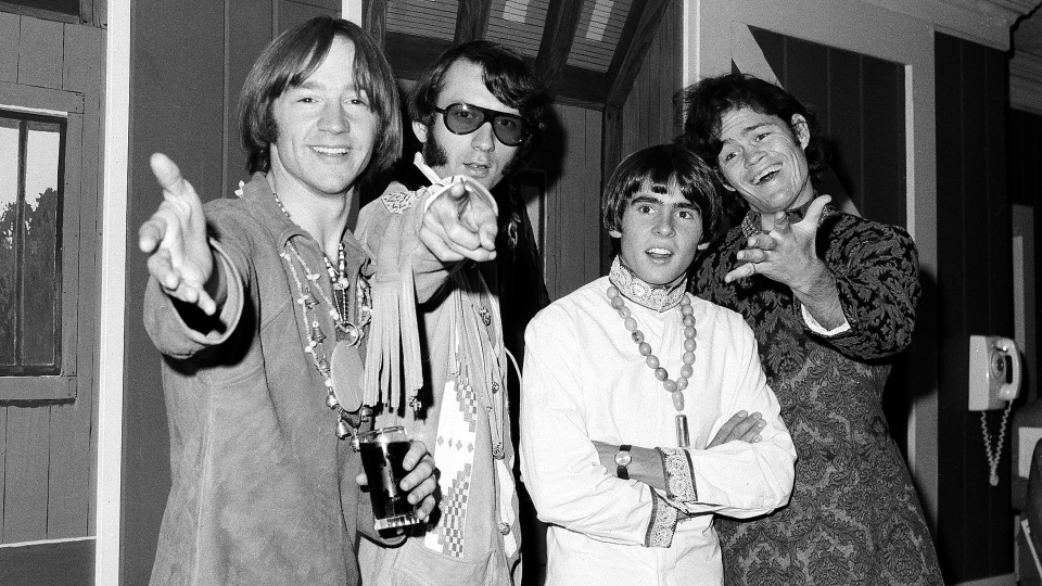 This July 6, 1967 file photo shows, from left, Peter Tork, Mike Nesmith, David Jones and Micky Dolenz of the musical group The Monkees at a news conference at the Warwick Hotel in New York. (AP Photo/Ray Howard, File)