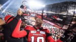 Calgary Stampeders quarterback Bo Levi Mitchell hoists the Grey Cup after defeating the Ottawa Redblacks in the 106th Grey Cup CFL championship football game in Edmonton, Alta., on Sunday November 25, 2018. Stampeders general manager John Hufnagel says he's optimistic he can re-sign quarterback Mitchell. THE CANADIAN PRESS/Darryl Dyck
