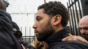 """Empire"" actor Jussie Smollett leaves Cook County jail following his release, Thursday, Feb. 21, 2019, in Chicago. Smollett was charged with disorderly conduct and filling a false police report when he said he was attacked in downtown Chicago by two men who hurled racist and anti-gay slurs and looped a rope around his neck, a police official said. (Ashlee Rezin/Chicago Sun-Times via AP)"