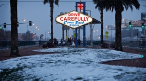 """Snow accumulates on a median along the Las Vegas Strip at the """"Welcome to Fabulous Las Vegas"""" sign, Thursday, Feb. 21, 2019, in Las Vegas. Las Vegas is getting a rare taste of real winter weather, with significant snowfall across the metro area in the first event of its kind since record keeping started back in 1937. (AP Photo/John Locher)"""