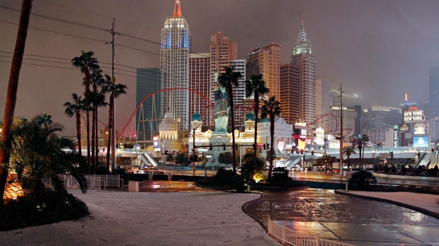 A dusting of snow covers an area along the Las Vegas Strip, Thursday, Feb. 21, 2019, in Las Vegas. A winter storm is expected to drop up to 3 inches (8 centimeters) of snow on Las Vegas' southern and western outskirts while other parts of the metro area will get rain mixed with snow. (AP Photo/John Locher)