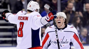 Washington Capitals left wing Alex Ovechkin (8) celebrates his goal with teammate T.J. Oshie (77) during second period NHL hockey action against the Toronto Maple Leafs, in Toronto on Thursday, Feb. 21, 2019. THE CANADIAN PRESS/Frank Gunn