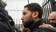 """""""Empire"""" actor Jussie Smollett leaves Cook County jail following his release, Thursday, Feb. 21, 2019, in Chicago. Smollett was charged with disorderly conduct and filling a false police report when he said he was attacked in downtown Chicago by two men who hurled racist and anti-gay slurs and looped a rope around his neck, a police official said. (Ashlee Rezin/Chicago Sun-Times via AP)"""