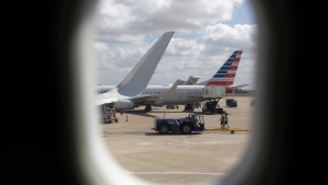 FILE- In this June 16, 2018, file photo, American Airlines aircrafts are seen at O'Hare International Airport in Chicago. (AP Photo/Kiichiro Sato, File)