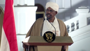 In this image taken from video, Sudan's President Omar al-Bashir speaks at the Presidential Palace, Friday, Feb. 22, 2019, in Khartoum, Sudan. Sudan's President has declared a state of emergency on Friday, for a year and disbanded the government amid deadly protests. Al-Bashir — who seized power in a 1989 coup— also said Friday that for now he will not change the constitution to allow himself to seek a third term in office. (AP Photo/Mohamed Abuamrain)