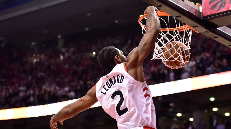 Toronto Raptors forward Kawhi Leonard (2) dunks after getting a turnover against San Antonio Spurs guard DeMar DeRozan (10) with 15 second left in second half NBA basketball action in Toronto on Friday, Feb. 22, 2019. THE CANADIAN PRESS/Frank Gunn