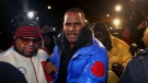 R. Kelly turns himself in at 1st District police headquarters in Chicago on Friday night, Feb. 22, 2019. R&B star R. Kelly arrived Friday night at a Chicago police precinct, hours after authorities announced multiple charges of aggravated sexual abuse involving four victims, including at least three between the ages of 13 and 17. (Chris Sweda/Chicago Tribune via AP)