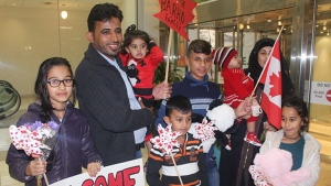 Members of the Barho family are shown upon arrival in Canada on Sept. 29 2017, at the Halifax airport in a handout photo. Seven children, all members of a Syrian refugee family, died early Tuesday in a fast-moving house fire described as Nova Scotia's deadliest blaze in recent memory. THE CANADIAN PRESS/Enfield Weekly Press-Pat Healey MANDATORY CREDIT